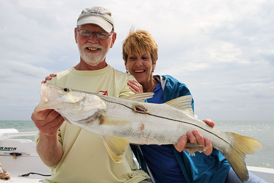 Mom and Dad with Dad's first snook